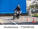woman l driver driving slalom... | Shutterstock . vector #776598760