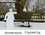 Portrait Of A Snowman Sitting...