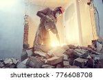 builder with hammer breaking... | Shutterstock . vector #776608708
