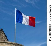 french flag waving in the wind | Shutterstock . vector #776651293