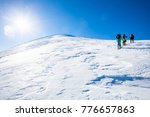 three skiers is climbing the... | Shutterstock . vector #776657863