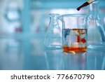 clear glass beaker with orange... | Shutterstock . vector #776670790