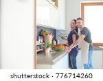 couple cooking together in... | Shutterstock . vector #776714260
