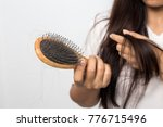 young woman worried about hair... | Shutterstock . vector #776715496