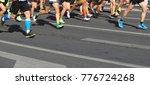marathon runner legs running on ... | Shutterstock . vector #776724268