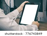 business woman holding tablet... | Shutterstock . vector #776743849