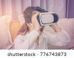 a woman wearing virtual reality ... | Shutterstock . vector #776743873