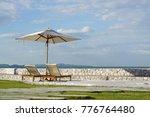 white color recliner beach... | Shutterstock . vector #776764480