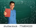 portrait of male student with... | Shutterstock . vector #776804320