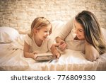young woman and her daughter... | Shutterstock . vector #776809330