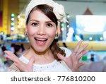 portrait of stylish pretty... | Shutterstock . vector #776810200
