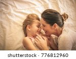 young  mother and daughter... | Shutterstock . vector #776812960