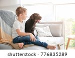 cute little boy with dog on... | Shutterstock . vector #776835289