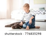 cute little boy with dog on... | Shutterstock . vector #776835298