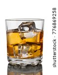 Small photo of Glass of scotch whiskey and ice on a white background with reflection isolated