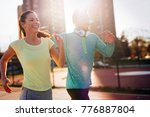 young attractive couple running ... | Shutterstock . vector #776887804