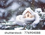 christmas toy house is wrapped... | Shutterstock . vector #776904088