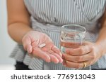 woman eat medicine. feeling... | Shutterstock . vector #776913043