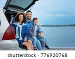 young family with boy sitting... | Shutterstock . vector #776920768