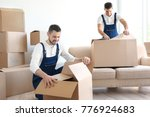 delivery men with moving boxes... | Shutterstock . vector #776924683