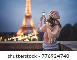 young girl makes a photo of the ... | Shutterstock . vector #776924740