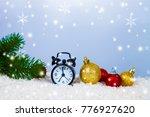 clock in a santa hat and balls... | Shutterstock . vector #776927620