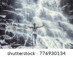 young woman on the waterfall | Shutterstock . vector #776930134