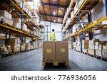 male warehouse worker pulling a ... | Shutterstock . vector #776936056