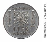Small photo of Old Albanian 1 Lek coin, circa 1939 isolated over white background