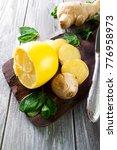 ginger  lemon and mint on a... | Shutterstock . vector #776958973