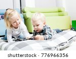 cute kids review the book | Shutterstock . vector #776966356
