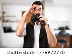 cool man with binoculars inside ... | Shutterstock . vector #776972770
