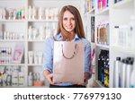 beautiful assistant saleswoman... | Shutterstock . vector #776979130