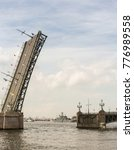 Small photo of Raised span of the Trinity Bridge. St. Petersburg, Russia - 28 July, 2017. Festive parade of warships on the Neva River in St. Petersburg.