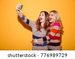 portrait of two excited girls... | Shutterstock . vector #776989729