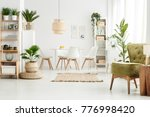 lamp on wooden stool and green... | Shutterstock . vector #776998420