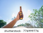 vacation concept. male hand... | Shutterstock . vector #776999776