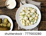 dinner with potato salad on... | Shutterstock . vector #777003280