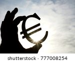 man's hand hold the euro icon... | Shutterstock . vector #777008254