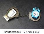 handcuffs  money and alarm...   Shutterstock . vector #777011119