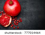 pomegranate and seeds close up... | Shutterstock . vector #777014464