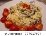 pizza with tomato  cheese and...   Shutterstock . vector #777017974