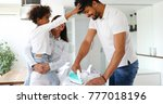 young couple at home doing... | Shutterstock . vector #777018196