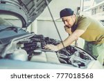 mechanical fixing car at home.... | Shutterstock . vector #777018568
