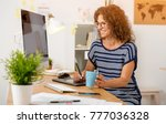 middle age designer working on...   Shutterstock . vector #777036328