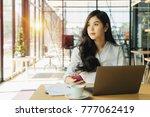 overworked businesswoman... | Shutterstock . vector #777062419