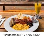 enjoing a big breakfast with... | Shutterstock . vector #777074530