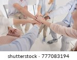 cropped shot of people stacking ... | Shutterstock . vector #777083194