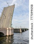 Small photo of Raised span of the Trinity Bridge. Excursion - tourist spots in St. Petersburg.