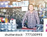 smiling adult man standing near ... | Shutterstock . vector #777100993